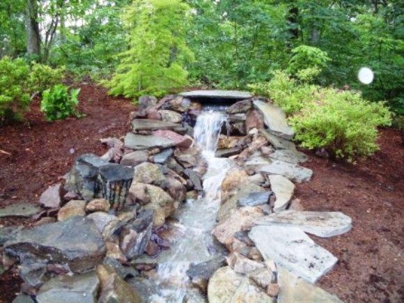 Streams by natural earth garden designs for Garden stream designs